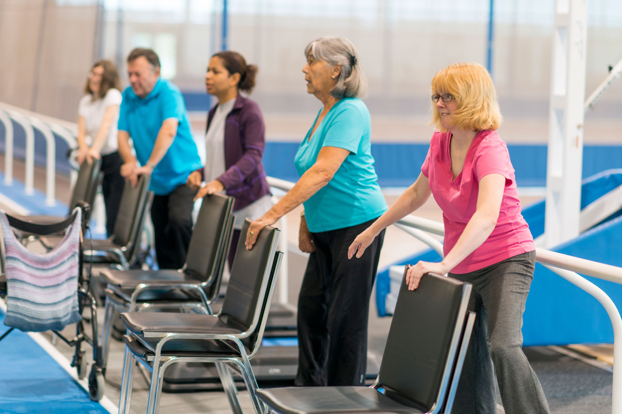 A group of older adults in group physical therapy.